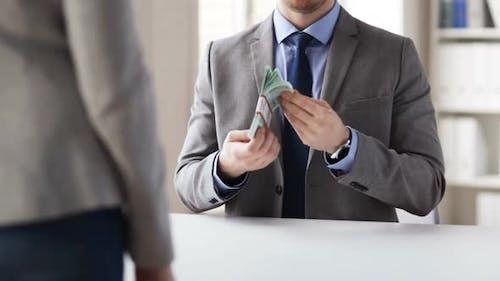 Close Up Of Businessman Taking Money Bribe 3
