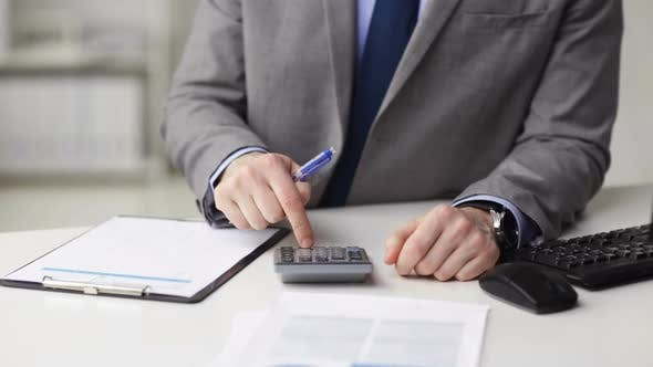 Thumbnail for Close Up Of Businessman With Papers And Calculator 1