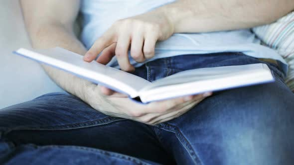 Thumbnail for Close Up Of Man Reading Book At Home 4