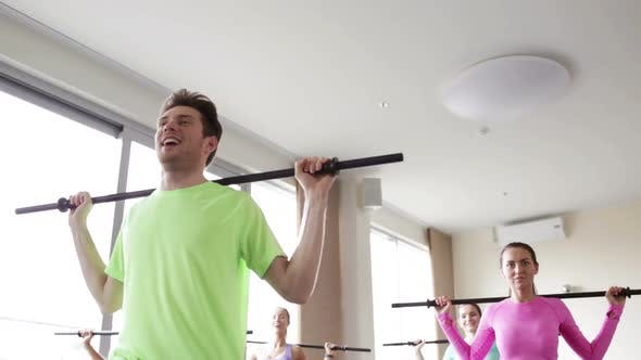 Thumbnail for Group Of People Exercising With Bars In Gym 7