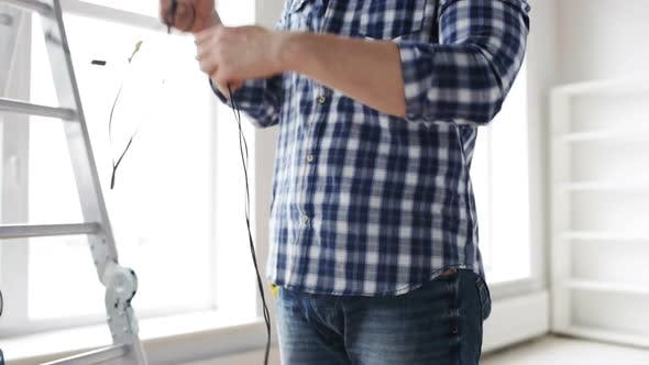 Thumbnail for Close Up Of Man Untangling Wires 1
