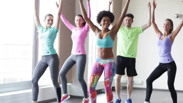 Thumbnail for Group Of Smiling People Dancing In Gym Or Studio 2