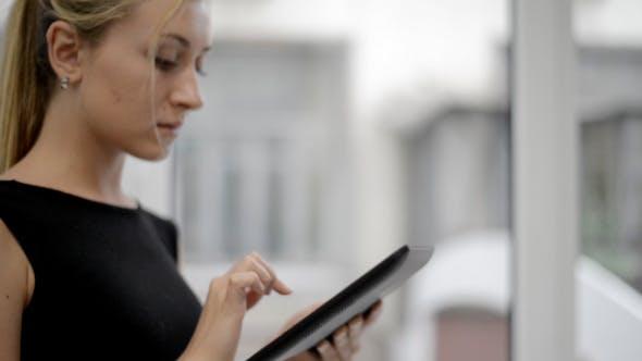 Thumbnail for Girl Using Digital Tablet