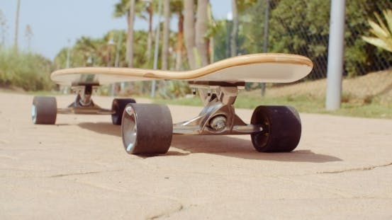 Thumbnail for Longboard Resting On The Ground At The Street