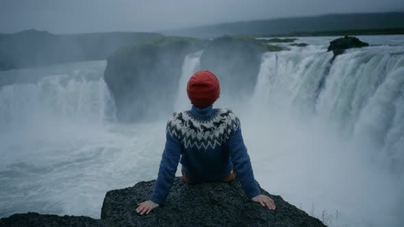 Thumbnail for Man in Wool Sweater on Edge of Waterfall Rock