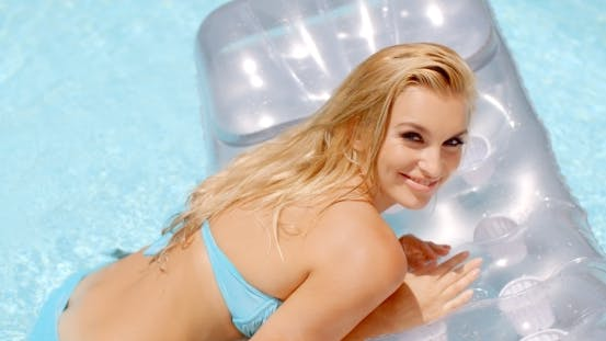 Thumbnail for Seductive Woman On a Floating Mattress In The Pool