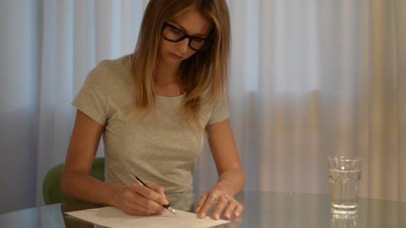 Thumbnail for Girl Reading Document