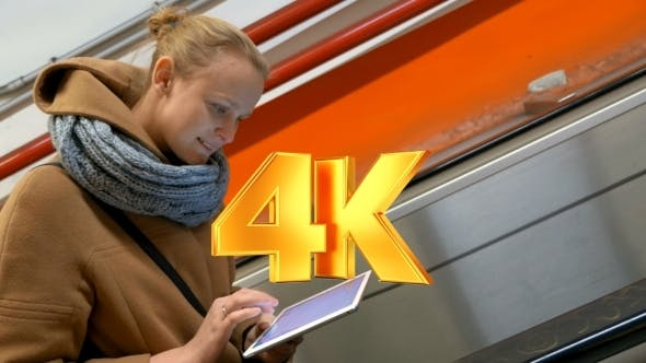Thumbnail for Woman On Escalator Using Tablet Computer
