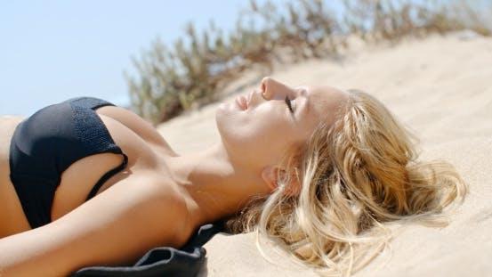 Thumbnail for Beautiful Girl Lying On Sandy Dune
