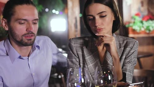Communication Problem. People Using Phone On Date At Restaurant