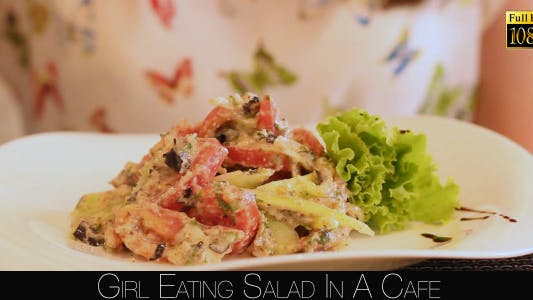 Cover Image for Girl Eating Salad In A Cafe 8
