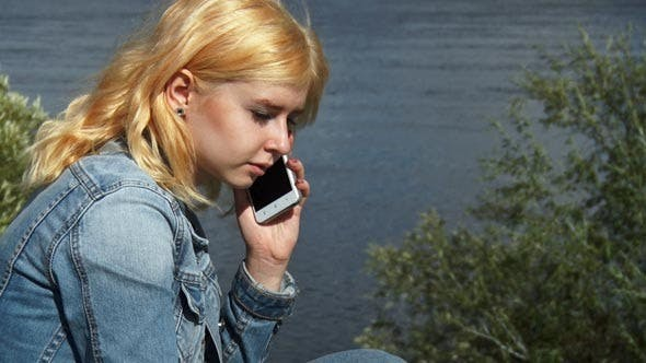 Thumbnail for Teenage Girl Talking on Mobile Phone