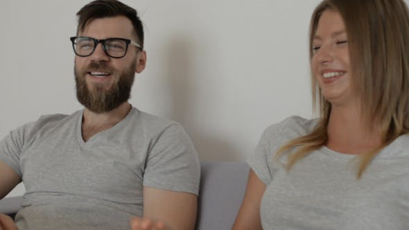 Cover Image for Happy Couple Talking and Smiling