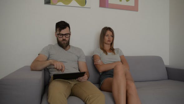Thumbnail for Couple After Fight , Man using Tablet