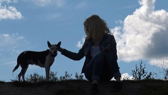 Thumbnail for Girl and Dog on the Background of Sky