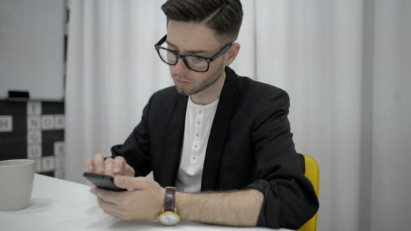 Very Busy Man Using Smartphone