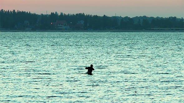 Thumbnail for A Man Checks Fishing Net In the Sea Before Dawn