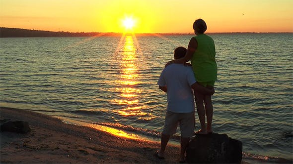 Thumbnail for Man and Woman With the Beach Watching the Sunrise