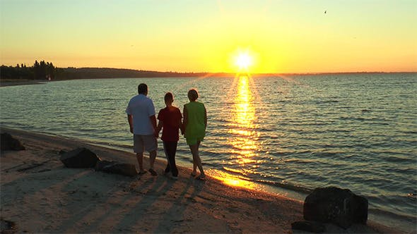 Thumbnail for Family on the Beach to Watch the Sunrise