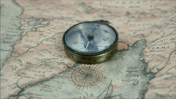 Thumbnail for The Compass and the Map on the Table
