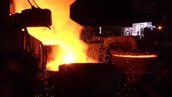Thumbnail for Boiling Metal in Steel Vessel Orange Light Smoke