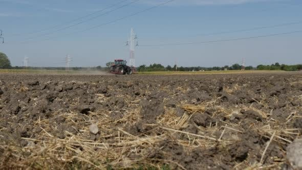 Thumbnail for Soil with Straw Close Up Tractor is Plowing on a