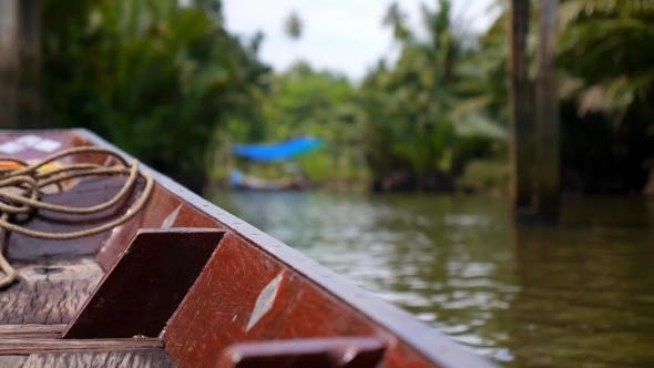 Thumbnail for Nose Of Longtail Thai Boat Floating In River In