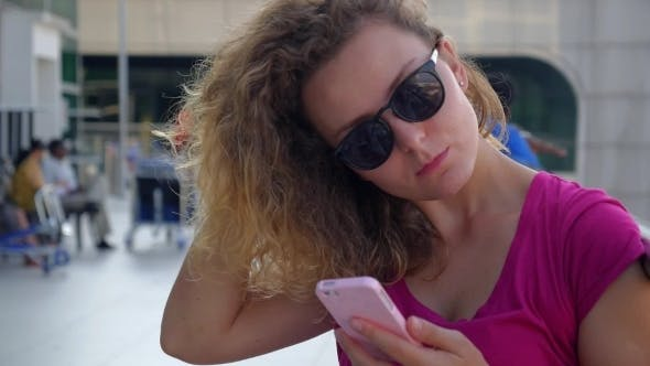 Thumbnail for Young Attractive Woman Using Phone Outdoor