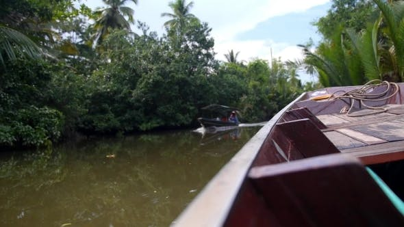 Thumbnail for Traditional Thai Wooden Boat Floating In River