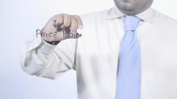 Asian Businessman Writes Price Points