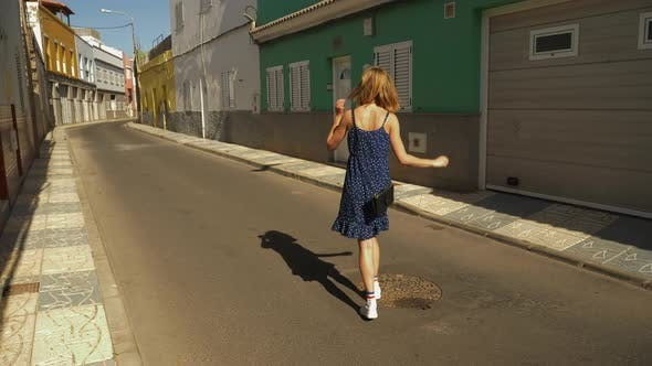 Thumbnail for Gorgeous Woman Walking Backwards on an Empty Street in Slow Motion