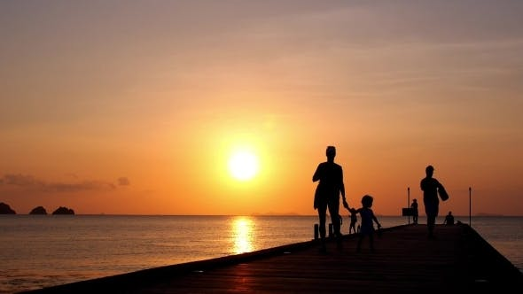 Thumbnail for Family Walking At Sunset On The Pier On Vacation