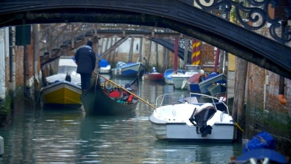 Thumbnail for Gondola Sailing Along The Water Canal In Venice