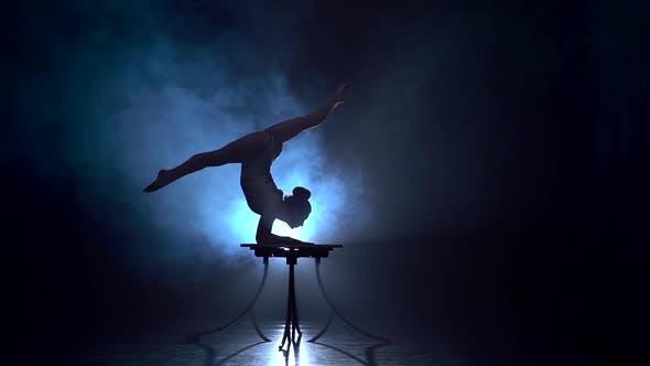 Thumbnail for Acrobat Girl Executes Tricks . Smoke Background. Slow Motion. Silhouette