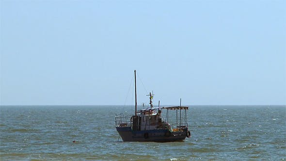 Pleasure Boat Anchored in the Sea on the Waves
