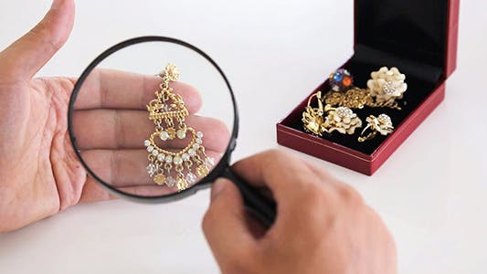 Thumbnail for Checking Jewel with a Magnifying Glass