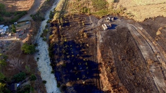 Thumbnail for Aerial View. Flight Over Field After Fire