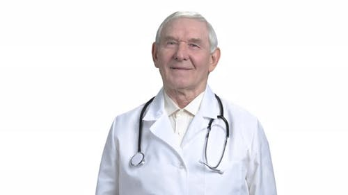 Old Caucasian Doctor in White Isolated Background.