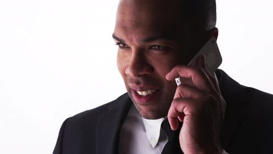 Thumbnail for Happy black businessman talking on smartphone