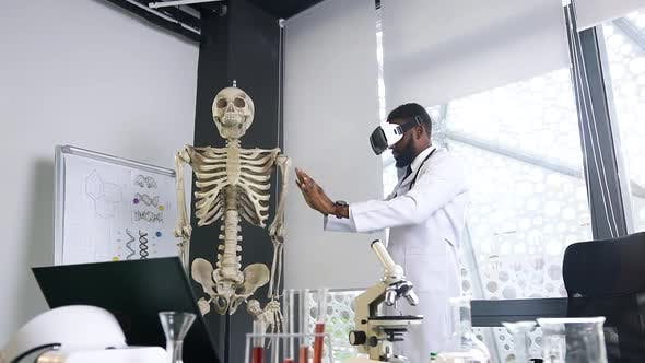 Doctor Learning the Human Skeleton Using Virtual Reality Headset in the Hospital Office