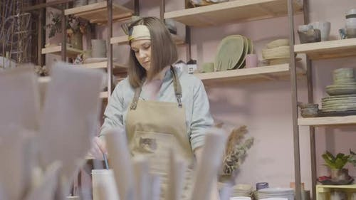 Good-looking Craftswoman Working in Pottery