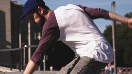 Thumbnail for Skateboarder Doing a Kickflip Down Set Of Stairs