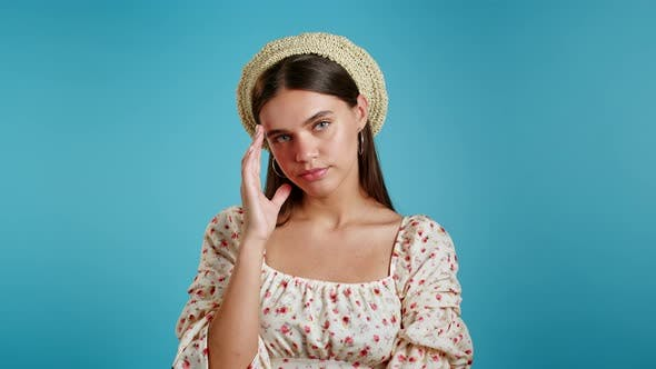 Thumbnail for Young Upset Woman Is Dissatisfied, Unhappy. Blue Studio Portrait of Girl, She Shaking Head Like