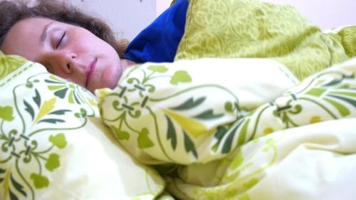 Beautiful Woman Sleeps In The Bedroom