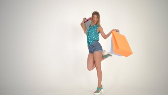 Thumbnail for Happy Girl Walking with Shopping Bags