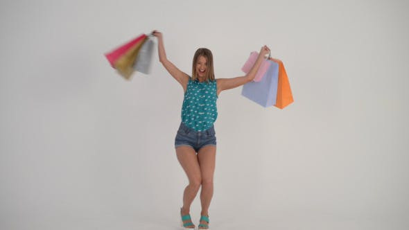 Thumbnail for Happy Girl Walking with Shopping Bags (2)