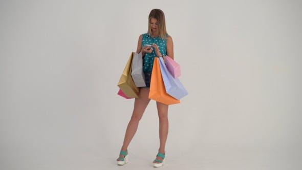 Thumbnail for Shopping girl Using Smartphone