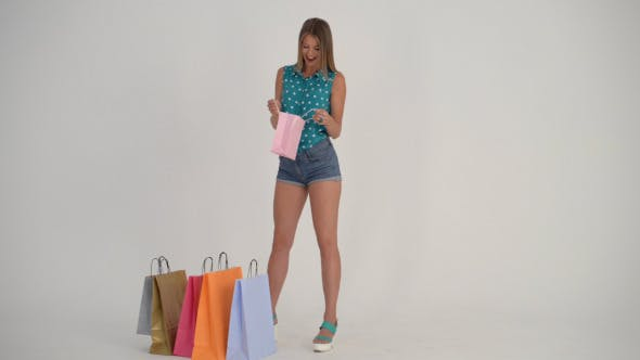 Thumbnail for Girl Excited to See in Shopping Bag