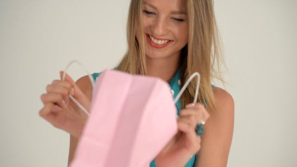 Cover Image for Excited Girl after Receiving Gift in Bag