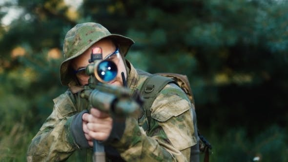 Thumbnail for Military Sniper Takes Aim At The Optical Sight